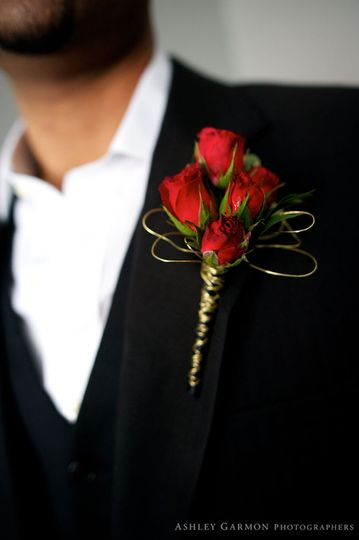 Spray roses create a tidy boutonnière