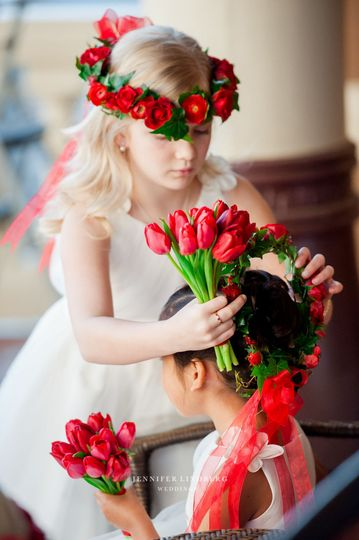 Flower girls adorned with beautiful red tulips