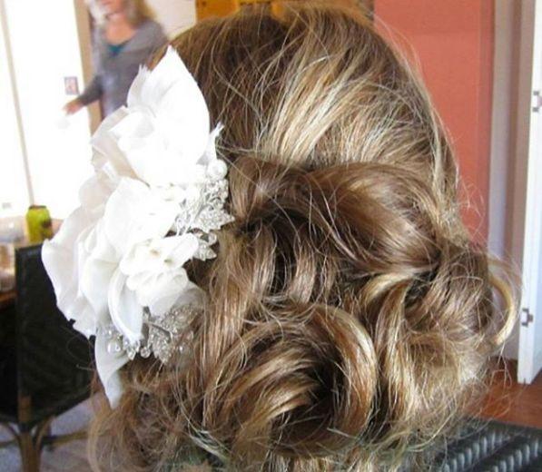 Hairdo by Chenda with large white flower ornament