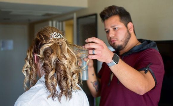 Jose styling the bride's hair