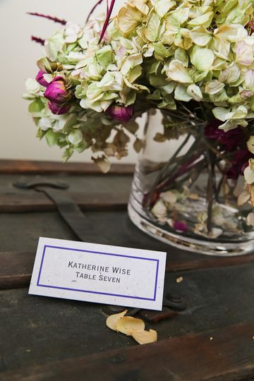 Navy Single Line Border place card printed on Eco Banana paper and guests names in Copperplate...