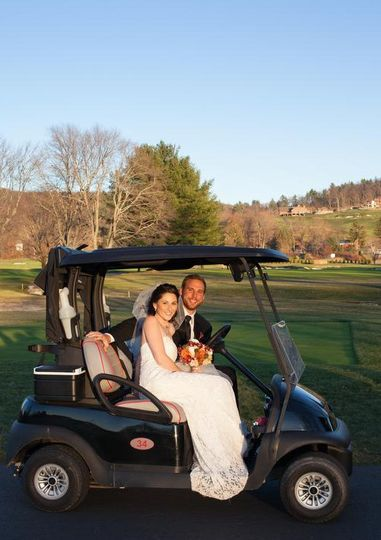 Couple riding the golf cart