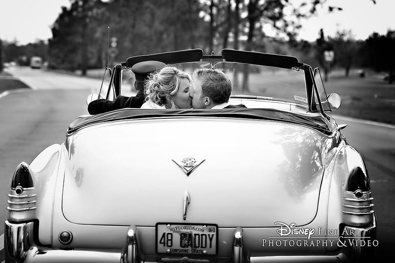 Newlyweds kissing in the car | Photo Credit: Crickets Photography
