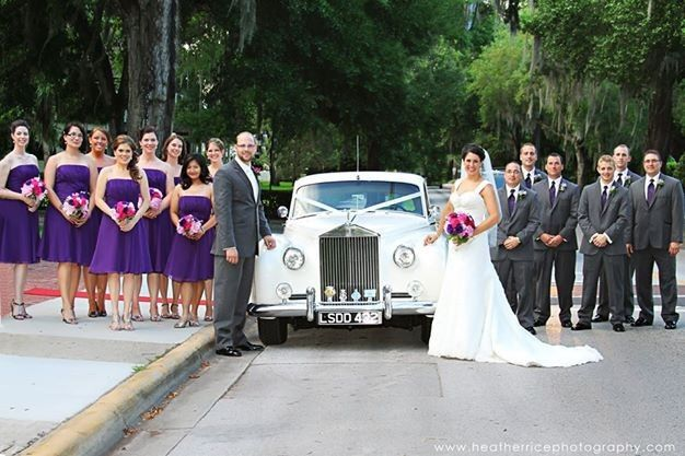 Newlyweds and their guests by the car