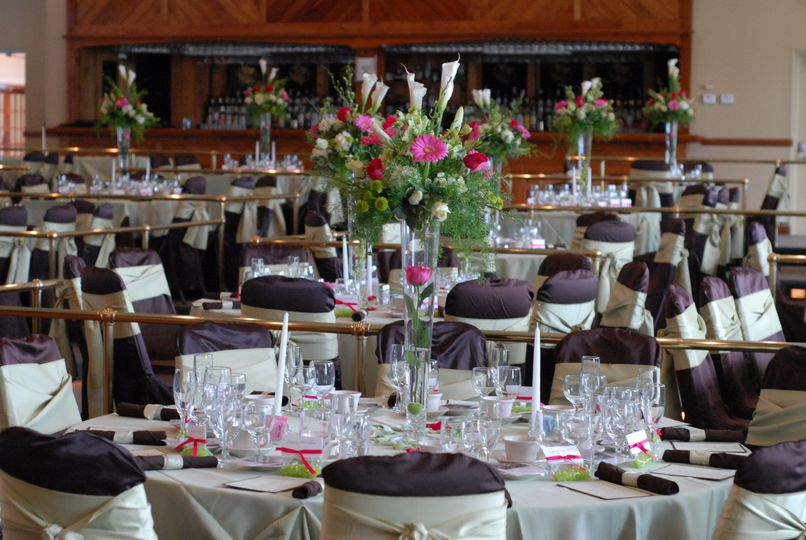 Lovely table setting, linens, and flowers in the Grand Room