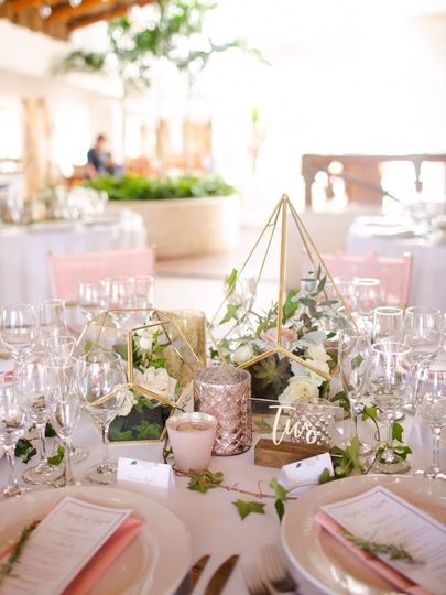 Dreamy tablescape with blush tones and gold terrariums
