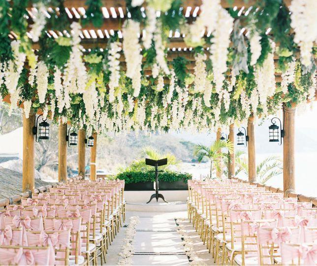 Cascading flowers ceremony setup