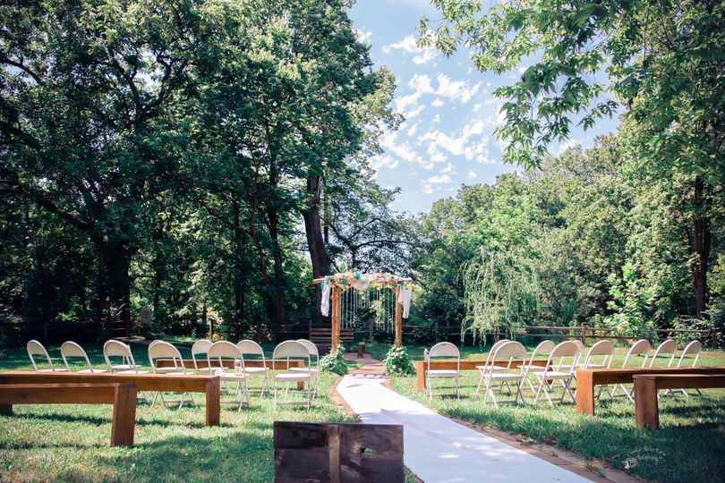 Rustic wedding ceremony set up at Crooked River Farm Weddings LLC. Photo by Crooked River Farm...