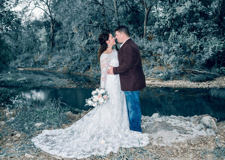 Couple's portrait by the Crooked RiverPhoto by Crooked River Farm Photography LLC