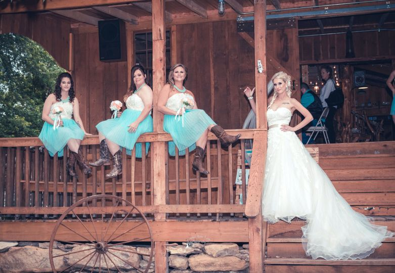 Bride with her bridesmaids.Photo by Crooked River Farm Photography LLC.