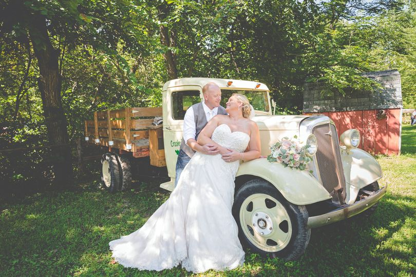 Couples with old truck