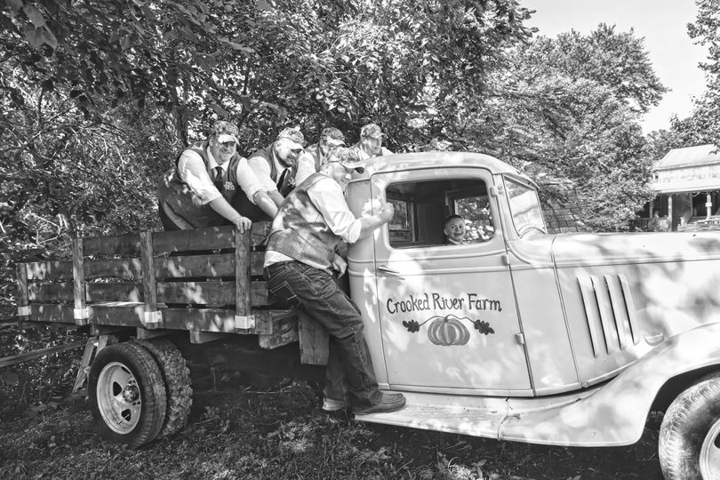 Groomsmen with old truck.