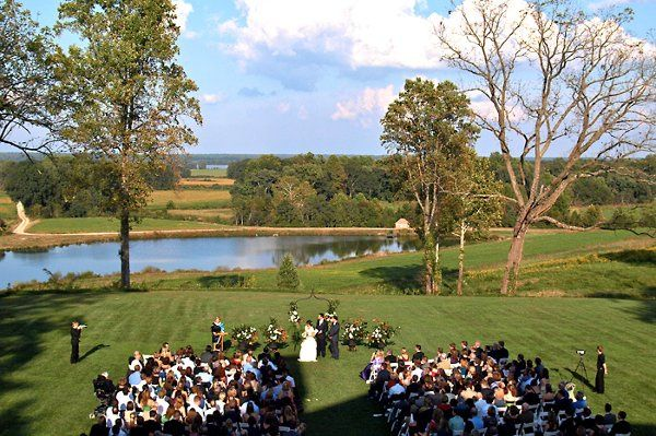 Wedding ceremony held behind the mansion.