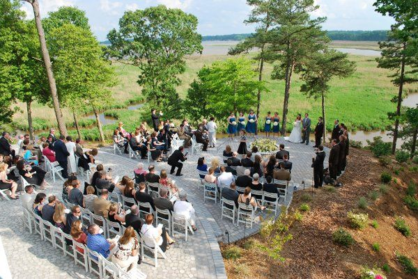 Wedding ceremony held on stone terrace behind the lodge. Overlooks the Rappahannock River.