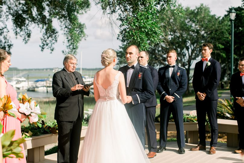 Wedding Ceremony on the deck at Bostwick Pavilion - Moss Creek.  Photo by Jessica Gold Photography