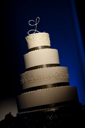 Four tier cake with black linings