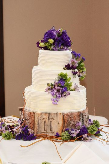 Three tier wedding cake with purple flowers
