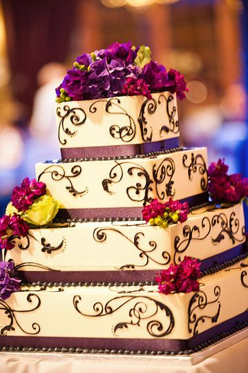 Four tier square cake with embellishments