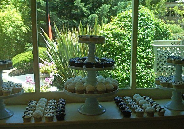 Beautiful display of cupcakes complimenting the bride's black/white theme.