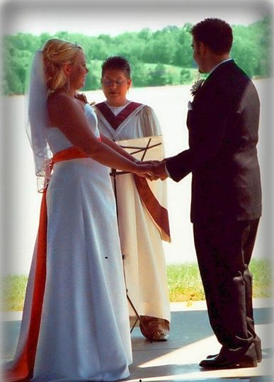 The officiant conducting a wedding event