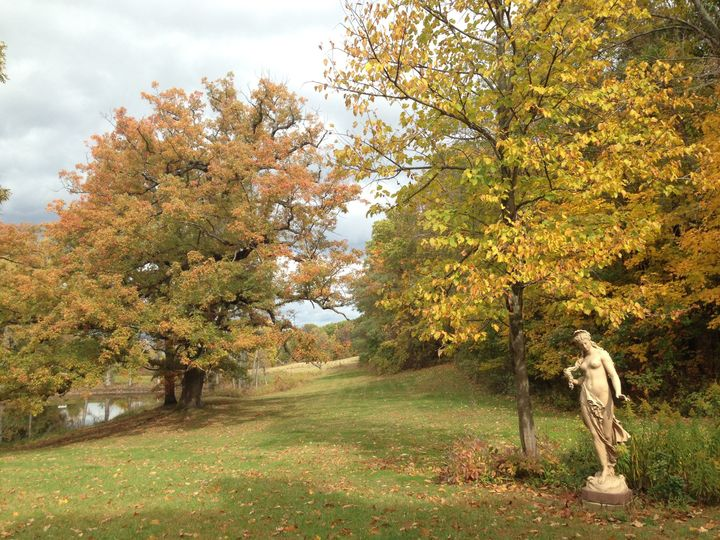 Aphrodite, the goddess of Love gracing the north grounds. Our acre pond is on the left.