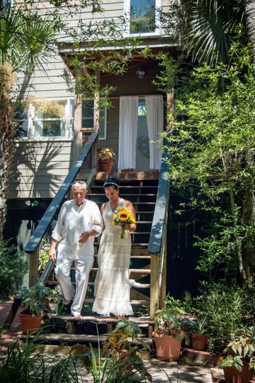 Bride walking in from cottage