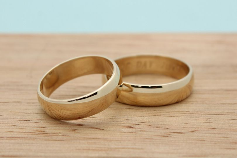 Classic wide bands in recycled 14k yellow gold.