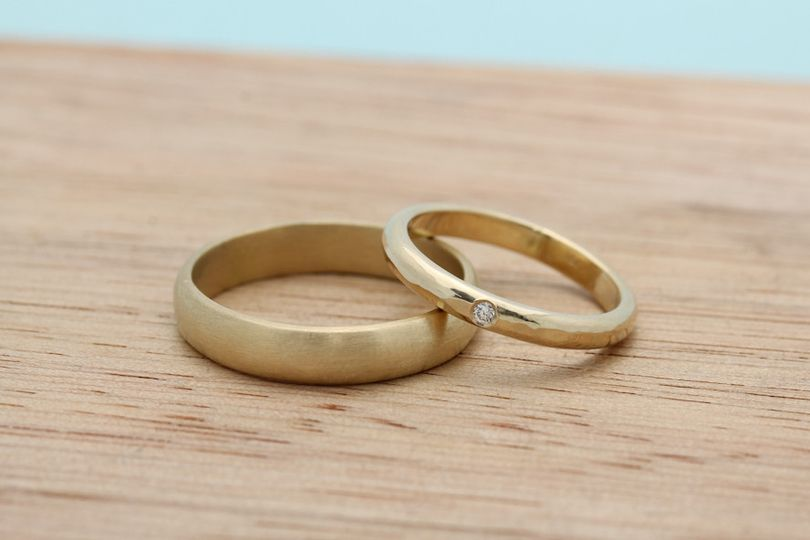 recycled gold bands with flush set diamond