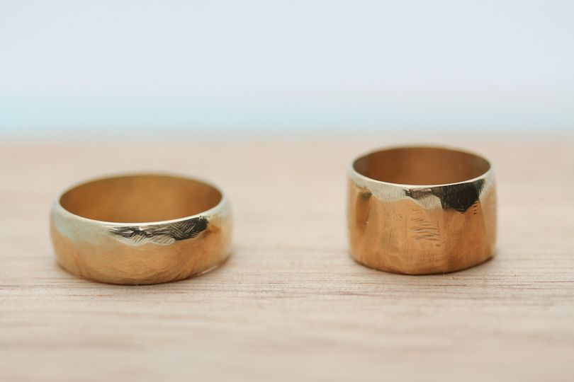 Hand carved, recycled yellow gold bands.