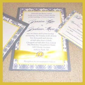 Beautiful damask pattern on linen textured cardstock with a classic ribbon accent and a crystal...