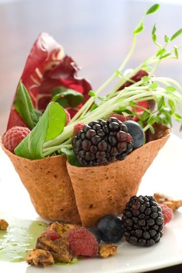 Lettuce and berry salad in crispy cup
