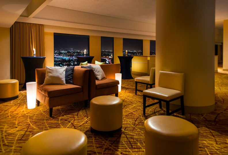 Utilize all of the space in the Skyline Room to create a lounge area for your guests
