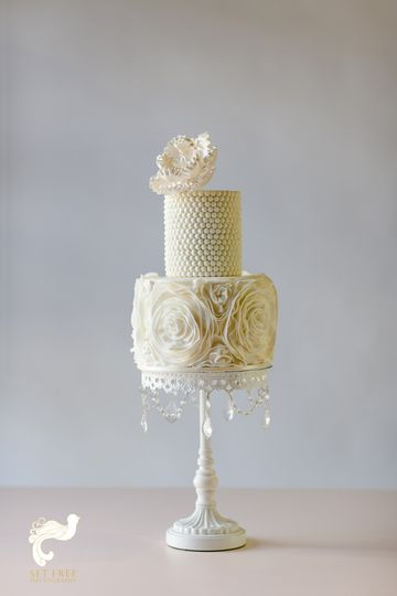 Textured white cake with tall platform