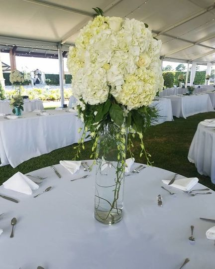 Table setup with tall floral centerpiece