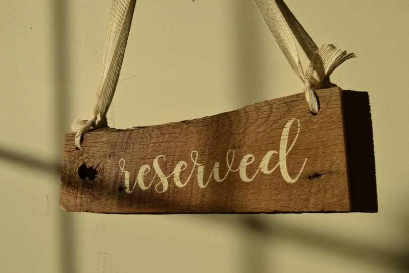 Place Reserved signs on your first isle for your special family and friends. Hand painted on...