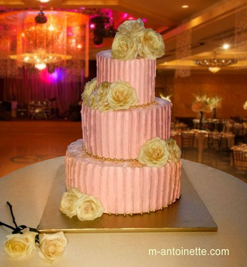 Tired of fondant? Here's one of our wedding cakes covered with soft pink Italian Meringue...