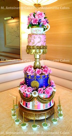 Pink, gold and lavendar rose celebration cake with sugar roses and tea cup.