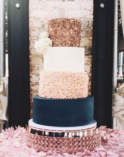 Navy and rose gold wedding cak