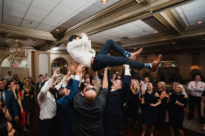 Groom crowd surfing!