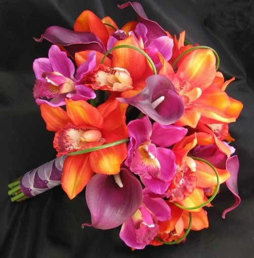 Bridal Bouquet - this natural touch bouquet features orange and purple orchids and purple calla...