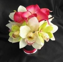 Table Centerpiece - features natural touch cream/white and green orchids and fuchsia calla lilies,...