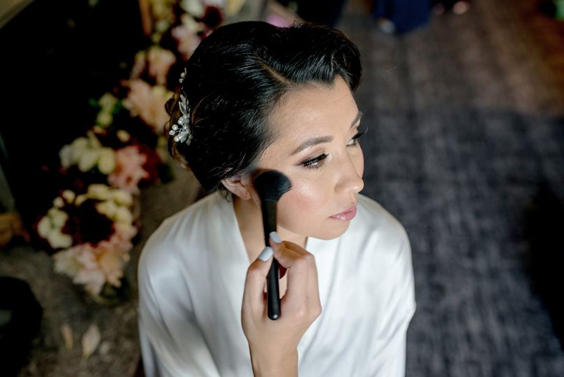 Doing the bride's makeup