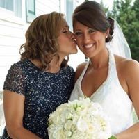 Bride kissed on the cheek