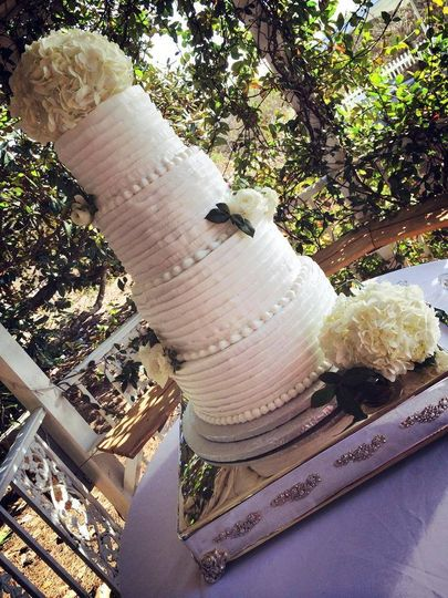 4-tier wedding cake with white flowers