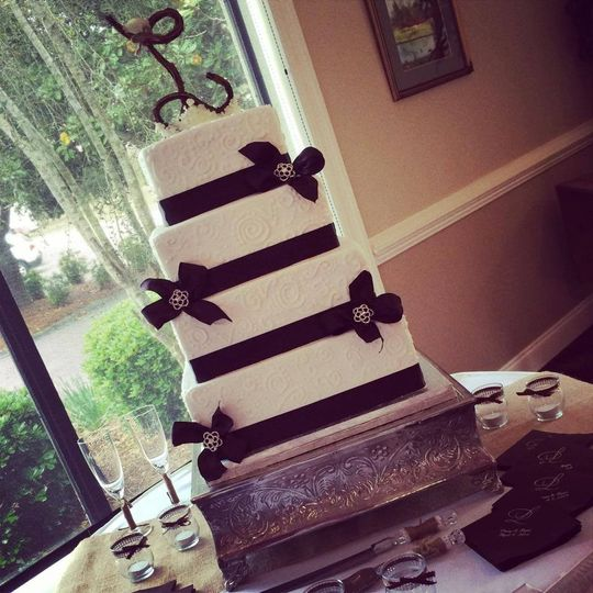 4-tier wedding cake with black ribbons