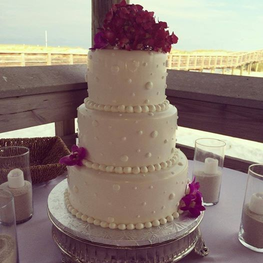 3-tier wedding cake with floral topper