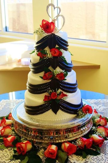 4-tier floral cake with black detailing