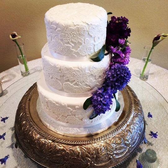 3-tier wedding cake with violet floral decor