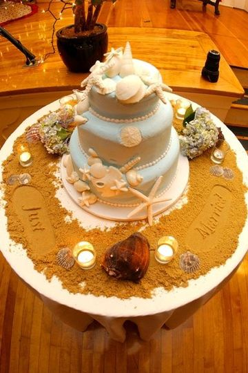 """With this beach cake, I surrounded it with brown sugar and then stamped """"just married"""" using special..."""