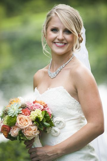 Happy bride with her bouquet